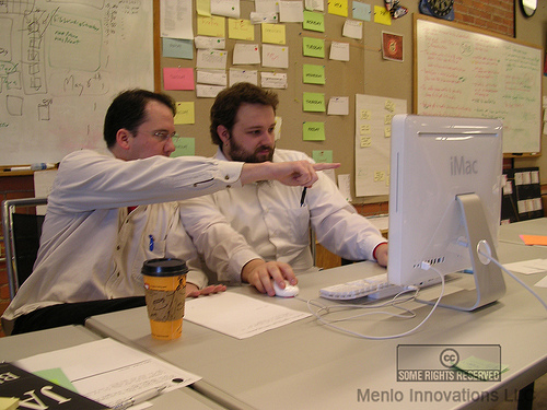 photo: two programmers pairing locally